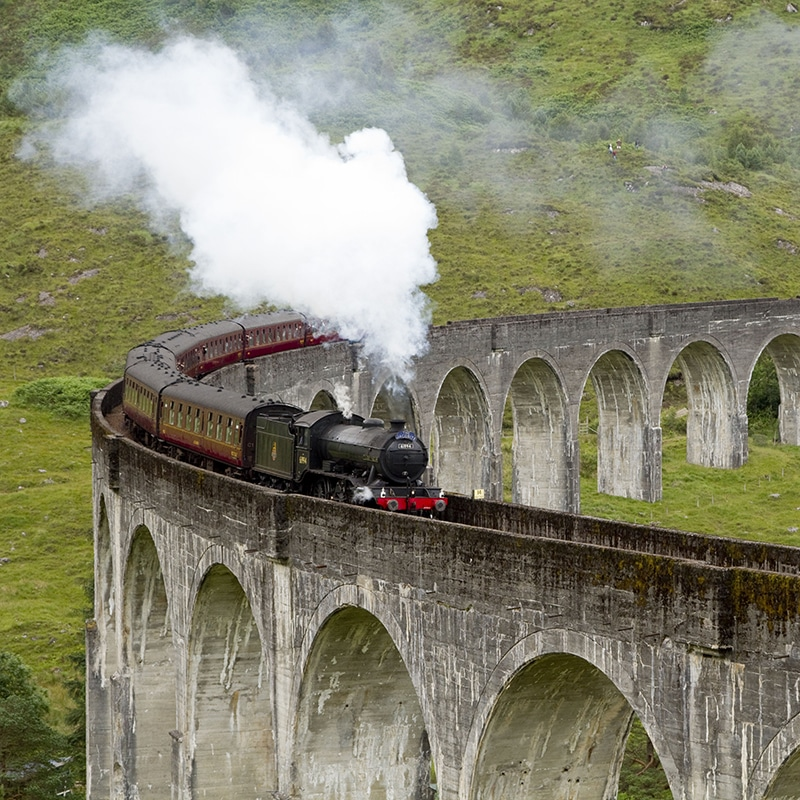 Jacobite steam train at Glenfinnan viaduct on highland tour