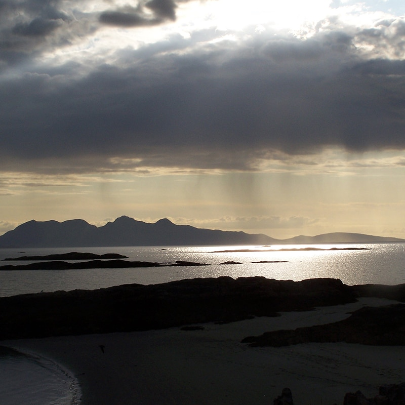 sunset at Arisaig overlooking the Isle of Rhum on blackrock tours of scotland