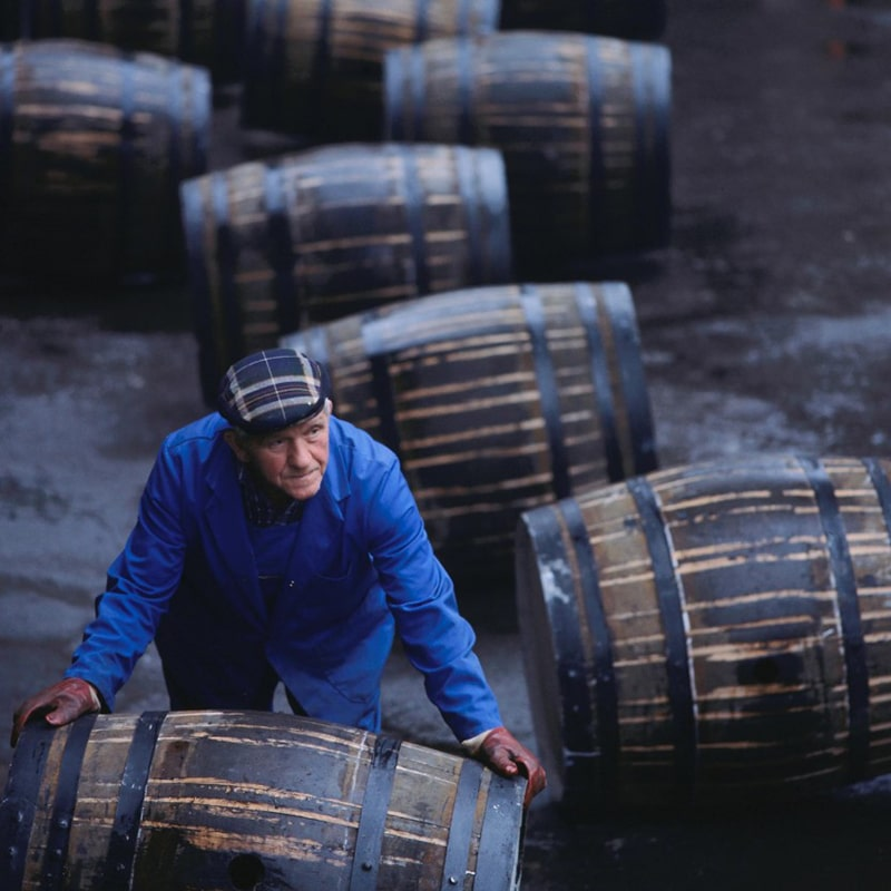 visiting a whisky distillery on whiskey tour Scotland